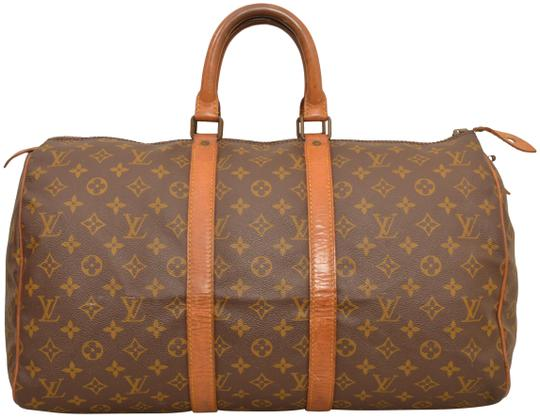 Preload https://img-static.tradesy.com/item/24327103/louis-vuitton-duffle-keepall-vintage-45-carry-on-luggage-m41428-brown-monogram-weekendtravel-bag-0-5-540-540.jpg