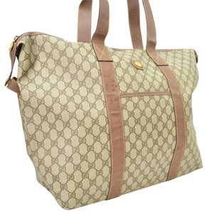 af2ffde3408 Gucci Tote Duffle Brown Coated Canvas Weekend Travel Bag - Tradesy