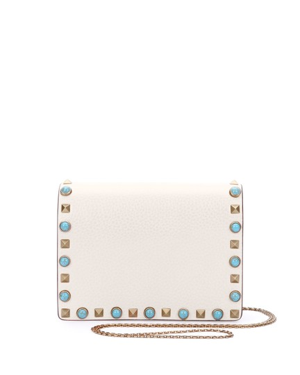 Preload https://img-static.tradesy.com/item/24332818/valentino-rockstud-blue-bead-flap-pouch-ivory-leather-clutch-0-0-540-540.jpg