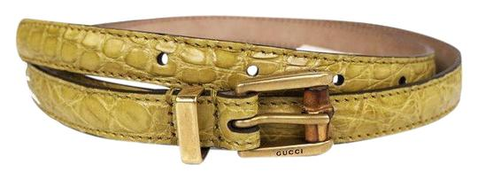 Preload https://img-static.tradesy.com/item/24333276/gucci-yellow-women-s-crocodile-leather-skinny-bamboo-buckle-summer-buckle-339065-size-32-belt-0-3-540-540.jpg