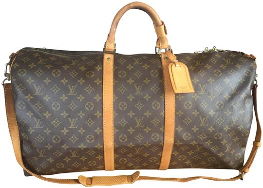 Preload https://img-static.tradesy.com/item/24336948/louis-vuitton-keepall-bandoliere-60-brown-monogram-canvas-and-leather-weekendtravel-bag-0-1-540-540.jpg