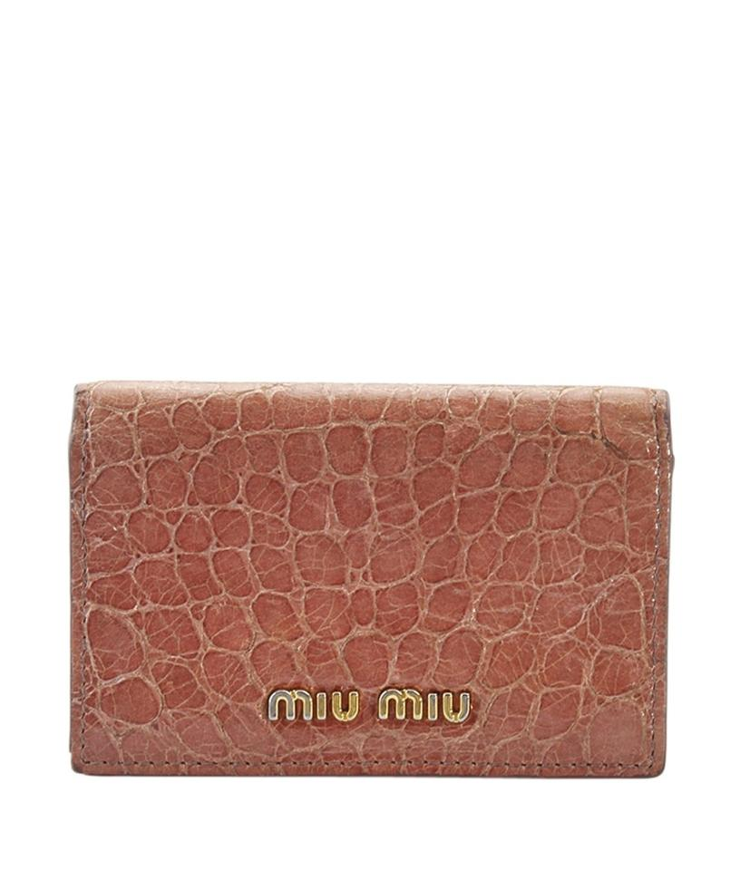 e0fa80bb956e Miu Miu Miu Miu Pink Embossed Leather Snap Wallet (160640) Image 0 ...