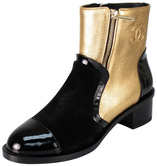 Preload https://img-static.tradesy.com/item/24343451/chanel-gold-blackgold-leather-suede-and-patent-leather-bootsbooties-size-eu-365-approx-us-65-regular-0-1-540-540.jpg