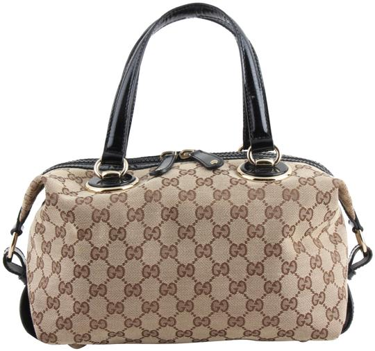 Preload https://img-static.tradesy.com/item/24343864/gucci-patent-leather-brown-canvas-satchel-0-1-540-540.jpg