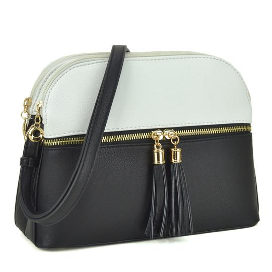 Preload https://img-static.tradesy.com/item/24344031/crossbody-messenger-with-tassel-whiteblack-faux-leather-cross-body-bag-0-0-540-540.jpg