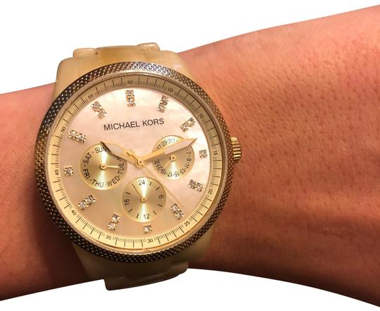 Preload https://img-static.tradesy.com/item/24347300/michael-kors-collection-beige-and-gold-watch-0-1-540-540.jpg