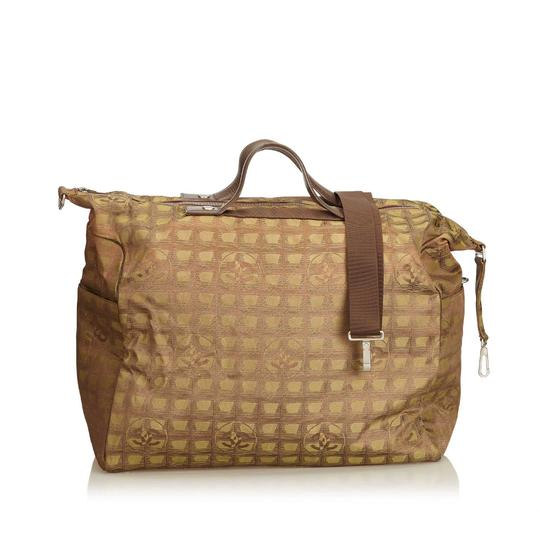 Preload https://img-static.tradesy.com/item/24348950/chanel-new-line-brown-fabric-x-jacquard-x-leather-x-others-weekendtravel-bag-0-0-540-540.jpg