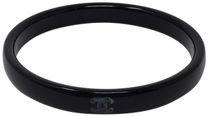 Chanel Gold-tone Chanel CC logo bangle black resin bracelet