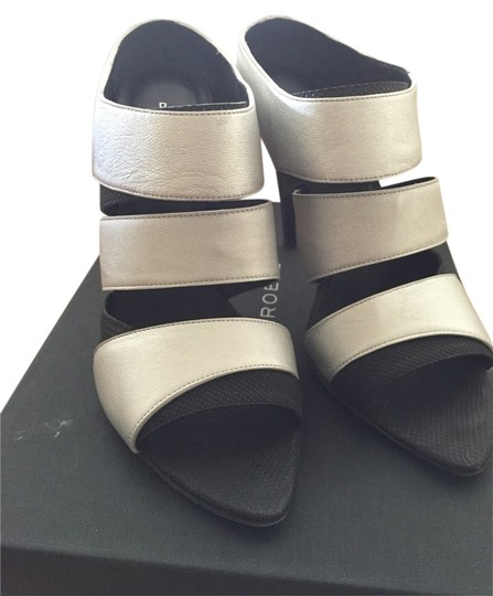 Preload https://img-static.tradesy.com/item/2436877/devi-kroell-black-and-silver-soire-sandals-size-us-85-narrow-aa-n-0-0-540-540.jpg