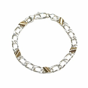 Tiffany & Co. Stunning Tiffany & Co. Silver and Gold Italian Curb Link Bracelet; made of 18k Yellow Gold and Sterling Silver. 7 inches Comes with Original Pouch!!