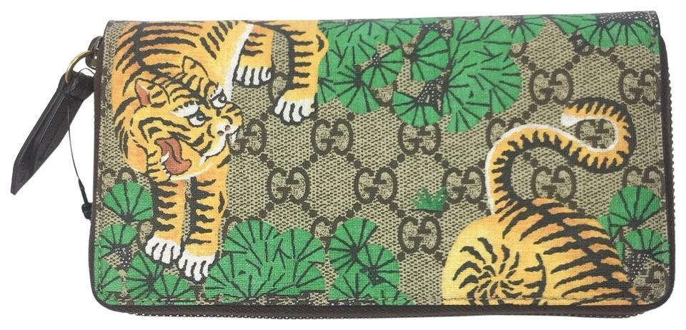 7a78f7518ed Gucci GG Supreme Bengal Tiger Print Zip Around Wallet  451468 Image 0 ...