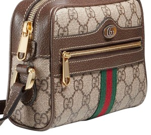 b6a3930a27d Added to Shopping Bag. Gucci Cross Body Bag. Gucci Ophidia Gg Supreme ...