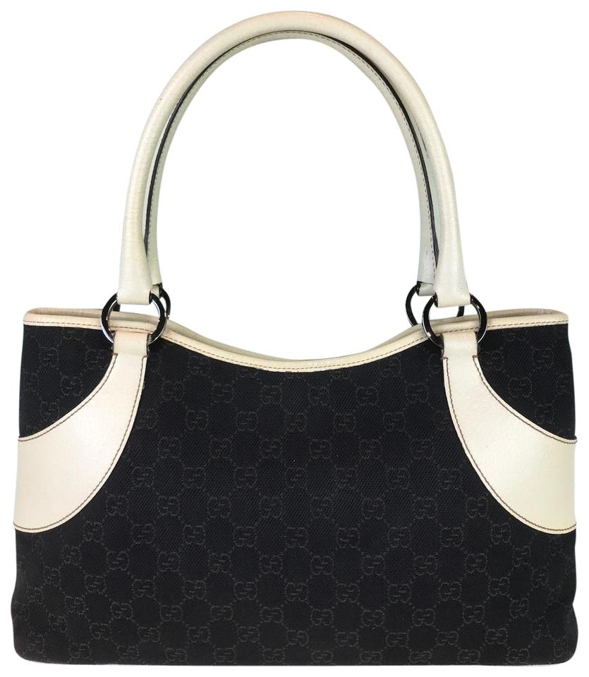 45ec3db0d6024d Gucci Ivory Leather Tote in Dark Brown Image 0 ...