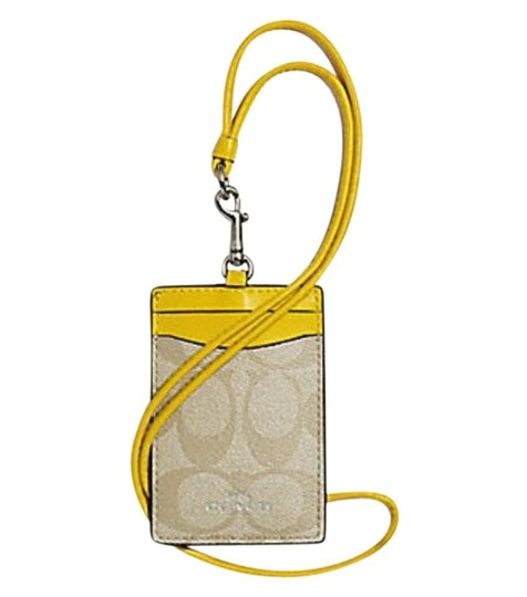 Preload https://img-static.tradesy.com/item/24388113/coach-canary-yellow-id-lanyard-in-signature-canvas-f63274-0-0-540-540.jpg