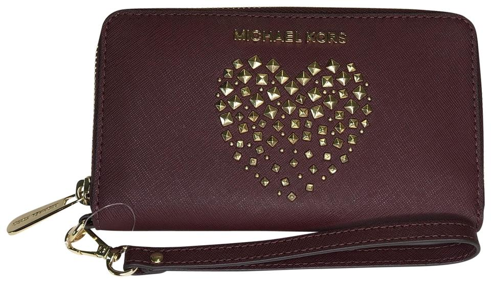 cc4d7ff9e171 Michael Kors Blue Paisley Admiral Leather Wristlet in Merlot Studded Heart  Image 0 ...