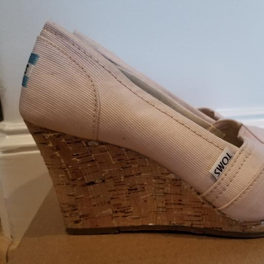 Preload https://img-static.tradesy.com/item/24389555/toms-pink-exclusive-to-neiman-marcus-worn-a-few-times-light-satin-wedges-size-us-65-regular-m-b-0-1-540-540.jpg