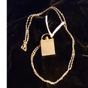 Chloé Chloé perfume solid bottle gold tone pendant and chain