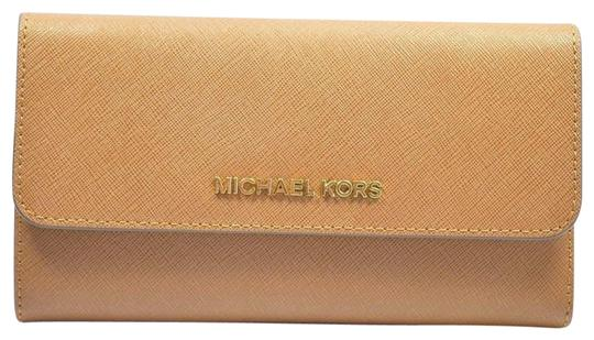 Preload https://img-static.tradesy.com/item/24391809/michael-kors-luggage-jet-set-trifold-wallet-0-1-540-540.jpg
