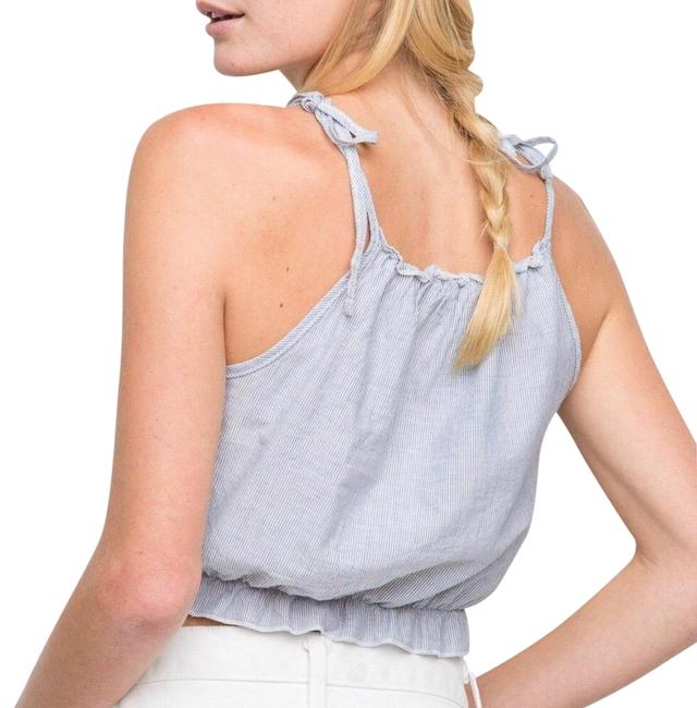 Preload https://img-static.tradesy.com/item/24392412/brandy-melville-white-blue-tie-tank-stripes-one-small-tee-shirt-size-4-s-0-1-650-650.jpg
