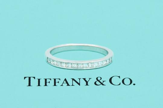 Preload https://img-static.tradesy.com/item/24395885/tiffany-and-co-f-vs-co-princess-cut-diamond-ring-platinum-26mm-women-s-wedding-band-0-0-540-540.jpg