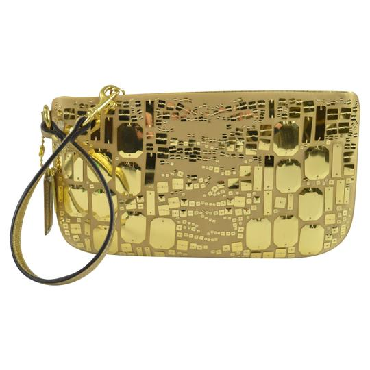 Preload https://img-static.tradesy.com/item/24396185/coach-pop-glitter-occasion-43778-gold-fabric-wristlet-0-1-540-540.jpg