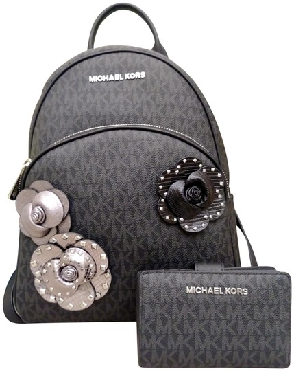 Preload https://img-static.tradesy.com/item/24396778/michael-kors-holiday-special-abbey-floral-embellished-and-jet-set-wallet-black-coated-canvas-backpac-0-1-540-540.jpg