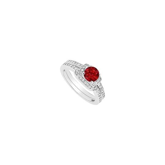 Preload https://img-static.tradesy.com/item/24397114/red-created-ruby-and-cubic-zirconia-engagement-with-wedding-band-set-ring-0-0-540-540.jpg
