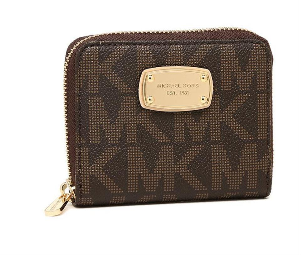 9c5034a6a2ea Michael Kors Michael Kors Jet Set Bifold Wallet zip around Signature PVC  Image 0 ...
