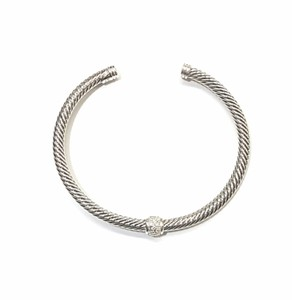 David Yurman BEAUITFUL!! David Yurman Sterling Silver Single Station Classic Cable Cuff Bracelet with Pavé Diamonds 4mm 0.22 carat Pavé Diamonds 100% Authentic Guaranteed!! Comes with Original David Yurman Pouch!!
