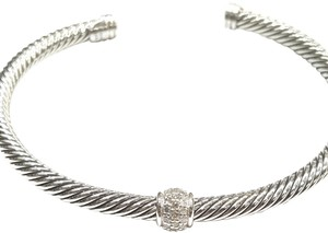 David Yurman BEAUITFUL!! David Yurman Sterling Silver Single Station Classic Cable Cuff Bracelet with Pavé Diamonds Sized Small, but very flexible! 4mm 0.22 carat Pavé Diamonds 100% Authentic Guaranteed!! Comes with Original David Yurman Pouch!!