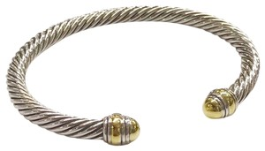 "David Yurman GORGEOUS!! LIKE NEW!!! David Yurman 14 Karat Yellow Gold and Sterling Silver Cable Classic 5mm Bracelet Cuff 14 Karat Yellow Gold Sterling Silver 5mm Size: Small 6.75"" 100% Authentic Guaranteed!!! Comes with Original David Yurman Pouch!!!"