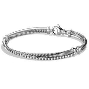 """David Yurman GORGEOUS!! LIKE NEW!!! David Yurman Crossover Diamond Cable Bracelet Sterling Silver Diamonds weighing 0.42 carats total weight 3mm Size: Medium 7.25"""" 100% Authentic Guaranteed!!! Comes with Original David Yurman Pouch!!!"""