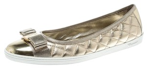 Salvatore Ferragamo Quilted Leather Gold Flats