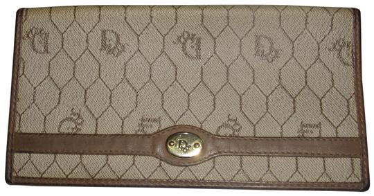Preload https://img-static.tradesy.com/item/24408411/dior-honeycomb-print-leathercoated-canvas-in-shades-of-brown-vintage-walletdesigner-wallet-0-1-540-540.jpg