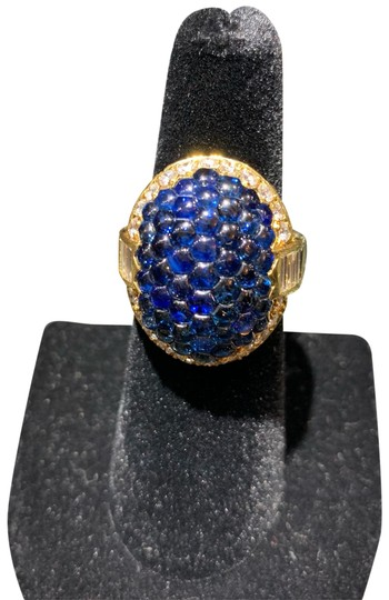 Preload https://img-static.tradesy.com/item/24408417/honeycomb-sapphire-and-brilliant-and-baguette-diamond-halo-ring-0-3-540-540.jpg