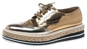 Prada Leather Metallic Platform Rubber Gold Flats
