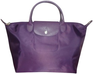 288ab42479c7 Added to Shopping Bag. Longchamp Tote in Bilberry. Longchamp Le Pliage Neo  Top Handle Medium ...