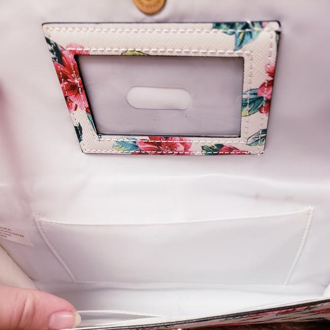 Guess Spring 2017 White Floral Leather Clutch Guess Spring 2017 White Floral Leather Clutch Image 1