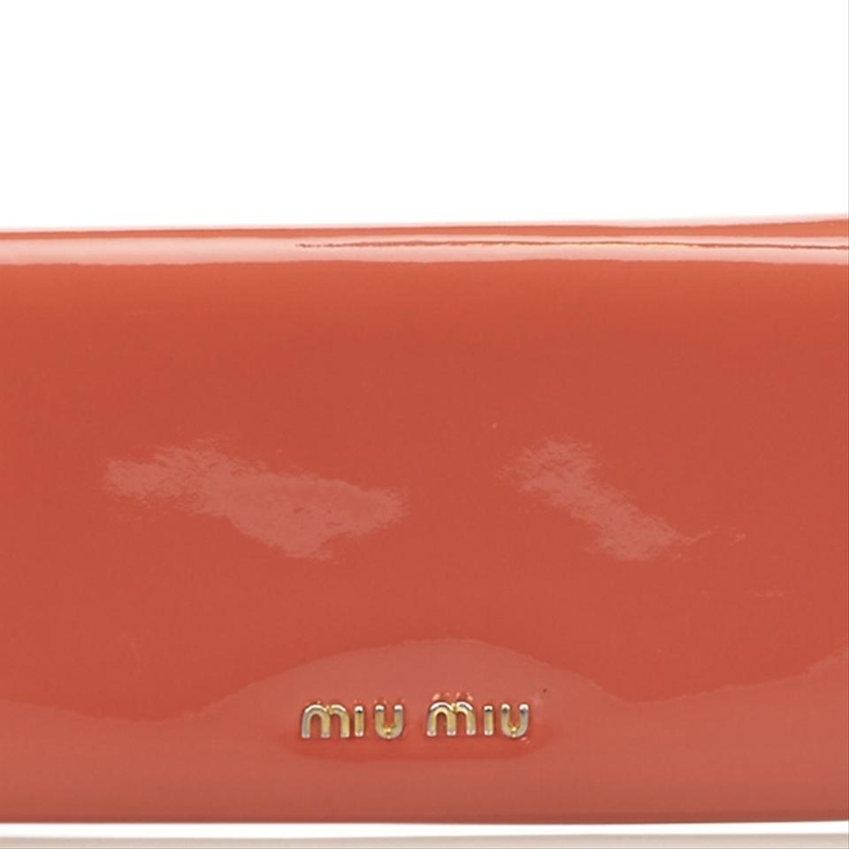 54dda0242b66 Miu Miu Patent Leather Bow Wallet Image 11. 123456789101112