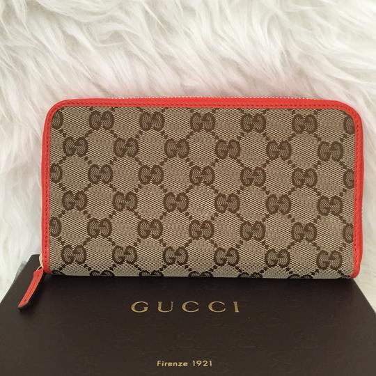 Preload https://item5.tradesy.com/images/gucci-orange-canvas-leather-with-zip-wallet-24424134-0-2.jpg?width=440&height=440