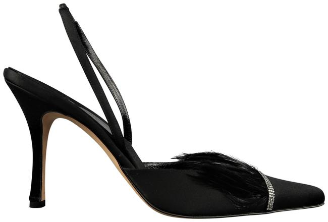 black pumps with feathers