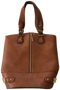 5a0a34d6f8d9 Added to Shopping Bag. jeane   jax Hobo Bag. Bucket Brown Vegan Leather ...