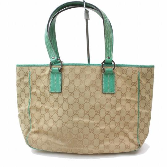 Preload https://img-static.tradesy.com/item/24429986/gucci-brown-and-signature-monogram-868913-green-canvas-tote-0-0-540-540.jpg