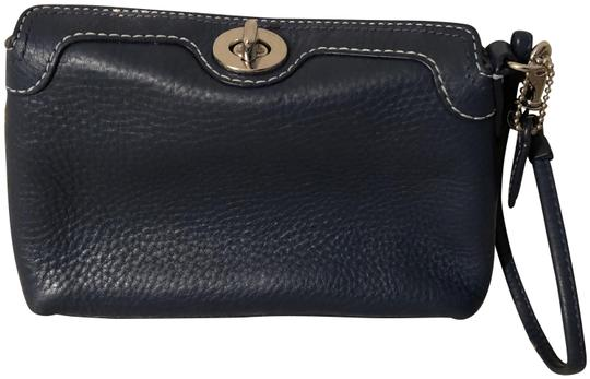 Preload https://img-static.tradesy.com/item/24430964/coach-navy-leather-clutch-0-1-540-540.jpg
