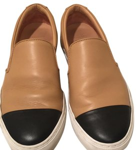 The Great. tan and black Flats