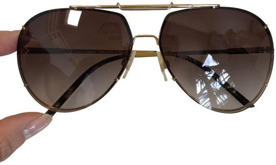 Preload https://img-static.tradesy.com/item/24434826/dolce-and-gabbana-brown-gold-avaitor-glasses-sunglasses-0-1-540-540.jpg