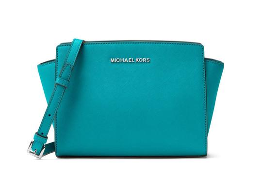 Preload https://img-static.tradesy.com/item/24435104/michael-kors-selma-saffiano-medium-tile-blue-leather-messenger-bag-0-0-540-540.jpg