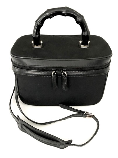 Preload https://img-static.tradesy.com/item/24435252/gucci-raaare-vintage-toilelry-vanity-train-case-with-bamboo-handle-euc-black-nylon-leather-weekendtr-0-0-540-540.jpg