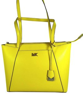 4c8ee87f82c5 Added to Shopping Bag. Michael Kors Leather 192317307658 Tote in Sunflower. Michael  Kors Maddie Medium East West ...