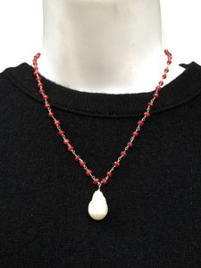 Ruby necklace with white freshwater baroque pearl